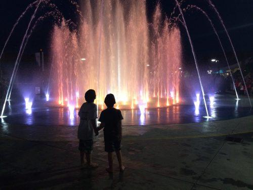 Boys at a summer fountain